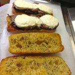 Casey Snowcap- Roast Beef & Fresh Mozzarella grilled into a garlic butter baguette.