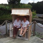 Interesting chairs by the pond
