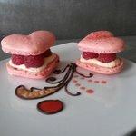 $2 Parisian Macaron, white chocolate ganache, raspberries