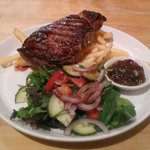 Scotch fillet 'seared and finished in the wood oven with salad, chunky fries & red onion relish'