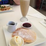 Pancakes with ice cream & maple syrup. I added the berries. Drink is a coffee frappe with a shot