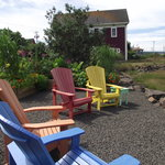 Relax in a colourful Adirondack at the water side.
