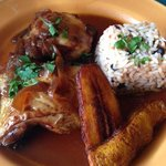 chicken with fried plantain, in orange & sherry sauce & blackbean rice
