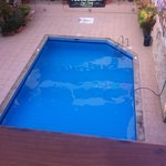 View from balcony - swimming pool at night (sun beds have been put away)