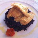 Black Venere risotto with persico fillets
