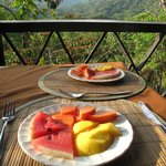 A delicious breakfast of local fruit on Hotel Minca's verandah.