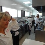 Margot Janse - hard at work! Notice the induction hubs - no more searing heat in the kitchen!