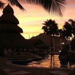 Sunset looking out towards marina by main pool & bar hut.