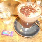 Coffee served with water and a chocolate