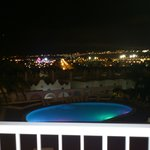 Lovely view of pool and town lit up at night.
