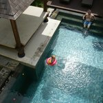 View of private pool from balcony upstairs