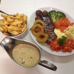 8oz Sirloin Steak Garni With A Side Of Sauce Of Your Choice