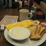 Breadfast of ham omelet,grits, toast, coffee