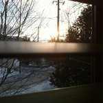Room 2. Sun coming up between the blinds.