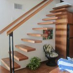 Stairs to upper two bedrooms in Suite 11