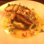 Pan fried salmon with crab mash, spinach and a prawn and crayfish butter sauce