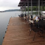 Perfect dock with porch swings, breakfast tables, ladder for easy swimming access, padded boat s