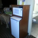 Cute stand to house microwave & fridge