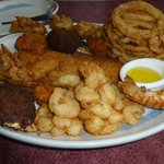 We share this Shore Dinner....Fish, Shrimp, Lobster, scallops, Onion Rings and more