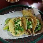 Three tacos--chicken, shredded beef, carnitas.