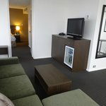 Separate lounge with big TV, good minibar, room service