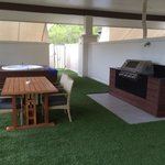 Rooftop spa, BBQ and dining area on one bedroom apartment.