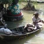 "one of two sellers in ""ayutthaya floating market"""
