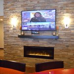Relaxation/Dining Area with Fireplace and TV