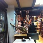 interior with jamon and old cash register
