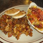 Country scrambled eggs with home fries and muffin
