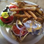 Gyro plate with lemon fries and a side salad.