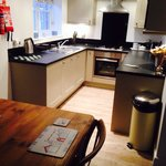 Kitchen. Has dishwasher, microwave and washing machine along with loads of cutlery and crockery