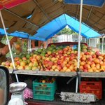 On the road selling mangos.