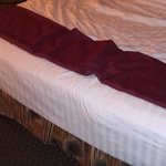 see the bow in bed. really old. we rolled to center. Hilton garden inn next time. yeck...