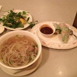 Spring rolls, beef pho soup with vegetables