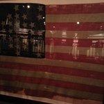 original flag taken down at beginning and raised at end of war