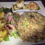 Scallops with side order of fried rice, grilled potatoes, and mixed vegetables