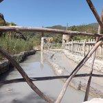 stream of mud supplying the pool