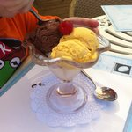 Three scoop ice cream-many flavours to choose from. This one is chocolate, mango and vanilla.