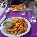 Crispy Chips and Real Mushy Peas. Large Fish with Light Tasty Batter in the background.