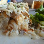 """""""Mero Special""""  (lobster-stuffed grouper fillet crusted in almonds with coconut/vodka sauce)"""