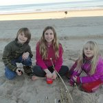 Grandkids on beach in front of Princess Royale