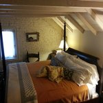 The king bed in the Attic Suite.
