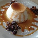 Vanilla bean panna cotta with a wine reduction glaze and caramelized raisins. Amazing.