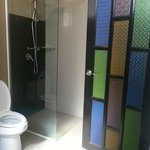 Lovely use of coloured glass on the bathroom door.