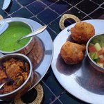 Vegetable Samosa served Mint and Tamarind Chutneys and Achar