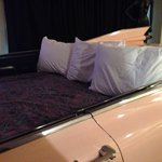 The bed in the Pink Cadillac. If your tall your feet will hit the dash. Didn't even bother with
