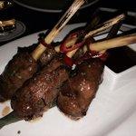 Lemongrass beef lollipops  NY strip beef wrapped in lemongrass, ginger citrus sweet glaze