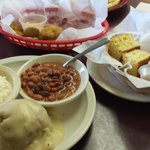 Cornbread dressing with cole slaw, pinto beans, and cornbread