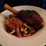 Braised lamb shank with fettuccine in tomato sauce
